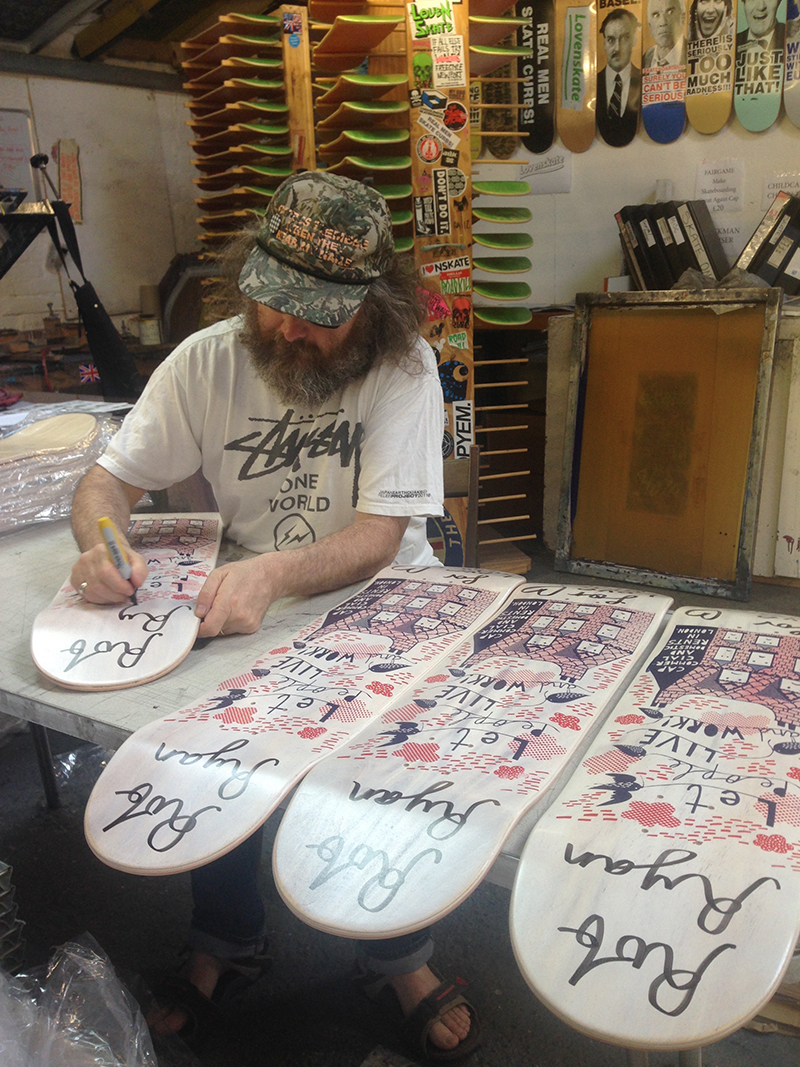 Rob Signing skateboard